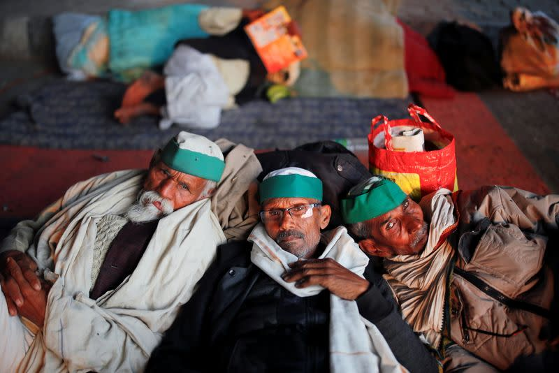 Farmers rest at the site of a protest against the newly passed farm bills at the Delhi-Uttar Pradesh border in Ghaziabad