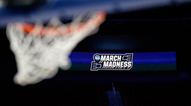 """<p>The first full day of the NCAA tournament is in the books, and Thursday's slate, while light on upsets, was high on drama and close finishes. <a href=""""https://www.si.com/college-basketball/2018/03/16/ncaa-tournament-arizona-loses-buffalo-sean-miller-deandre-ayton"""" rel=""""nofollow noopener"""" target=""""_blank"""" data-ylk=""""slk:Arizona was the highest seed to fall"""" class=""""link rapid-noclick-resp"""">Arizona was the highest seed to fall</a>, blown out by Buffalo in Boise, and <a href=""""https://www.si.com/college-basketball/2018/03/15/loyola-chicago-ramblers-donte-ingram-sister-jean-ncaa-tournament-tennessee"""" rel=""""nofollow noopener"""" target=""""_blank"""" data-ylk=""""slk:Loyola-Chicago sent Miami home with a last-second three"""" class=""""link rapid-noclick-resp"""">Loyola-Chicago sent Miami home with a last-second three</a>. Now what's in store for Friday? Before No. 1 overall seed Virginia tips off tonight, the defending national champs begin their repeat bit when North Carolina hosts Lipscomb. Later on, top NBA prospects Mo Bamba (Texas) and Michael Porter Jr. (Missouri) make their tournament debuts in Nashville.</p><p>Below you'll find recaps of every game of the first round's second day, along with a full schedule and TV guide for a look at what's ahead. Follow along for results and updates on all of the games as the final buzzer sounds, and <a href=""""https://www.si.com/college-basketball/ncaa-mens-basketball-bracket"""" rel=""""nofollow noopener"""" target=""""_blank"""" data-ylk=""""slk:click here for a live look at the bracket."""" class=""""link rapid-noclick-resp"""">click here for a live look at the bracket.</a></p><h3>Friday's Results</h3><h3><strong>Texas A&M 73, Providence 69</strong></h3><p>The SEC has extended its record in this year's first round to 5–0 after Friday's first game, which found a measure of continuity at last down the stretch. Texas A&M missed its first 10 shots of the game, needing over six minutes of action to score, but the Friars failed to take advantage, trailed by one at halftime and ult"""