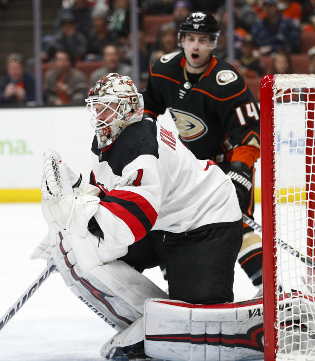 New Jersey Devils goaltender Keith Kinkaid makes a save in front of Anaheim Ducks' Adam Henrique during the second period of an NHL hockey game Sunday, March 18, 2018, in Anaheim, Calif. (AP Photo/Jae C. Hong)