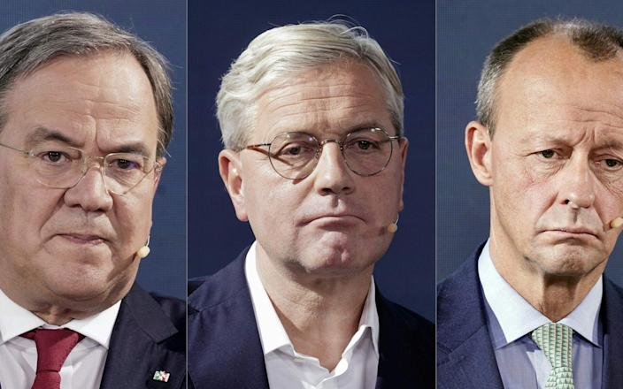 The three candidates for the leadership of the Christian Democratic Union party: From left to right, Armin Laschet, Norbert Röttgen and Friedrich Merz - MICHAEL KAPPELER/AFP via Getty Images