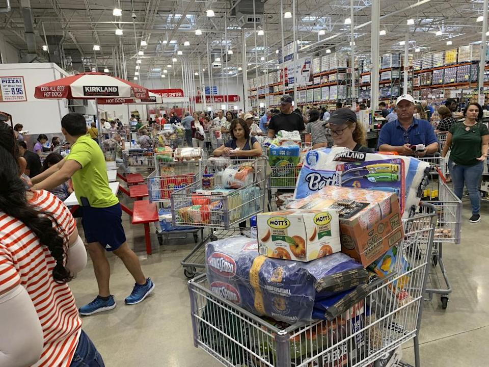 Shoppers in Florida wait in long lines as they stock up on supplies ahead of Hurricane Dorian.