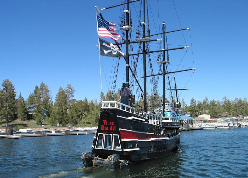 "In this May 24, 2005 photo courtesy of Dan McKernan shows a 43-foot pirate ship tour boat sank in Big Bear Lake, Calif. The one-third scale 16th century Spanish galleon replica was a prop in the movie ""Time Bandits."" The 27-ton boat has been docked at Holloway Marina, where it was found sunken on Saturday, March,1, 2014. (AP Photo/Dan McKernan)"