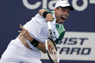 Roberto Bautista Agut, of Spain, serves to John Isner during the Miami Open tennis tournament, Tuesday, March 30, 2021, in Miami Gardens, Fla. (AP Photo/Marta Lavandier)