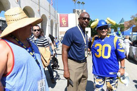Sep 18, 2016; Los Angeles, CA, USA; Joe Rincon of Santa Fe Springs, CA. gets a photo with NFL former player Eric Dickerson before the game between the Seattle Seahawks and the Los Angeles Rams at the Los Angeles Memorial Coliseum. Mandatory Credit: Jayne Kamin-Oncea-USA TODAY Sports