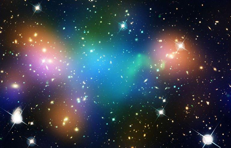 Undated composite image courtesy of NASA shows distribution of dark matter, galaxies, and hot gas in a galaxy cluster