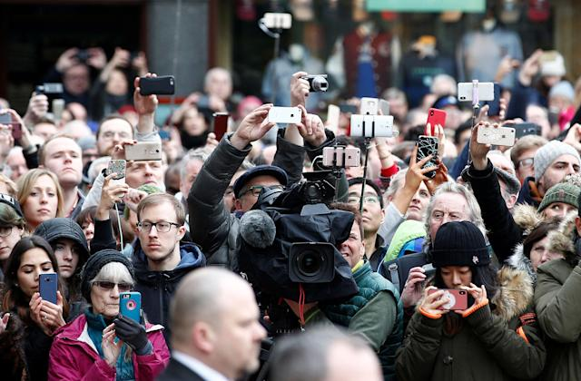 <p>Members of the public and media photograph the funeral cortege as it arrives at Great St Marys Church, where the funeral of theoretical physicist Prof Stephen Hawking is being held, in Cambridge, England, March 31, 2018. (Photo: Henry Nicholls/Reuters) </p>