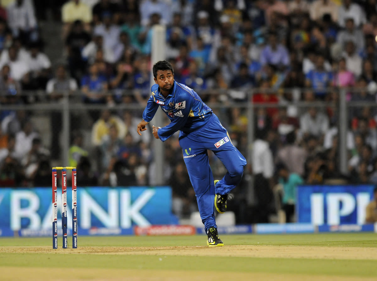 Pragyan Ojha of Mumbai Indians bowls during match 62 of the Pepsi Indian Premier League ( IPL) 2013  between The Mumbai Indians and the Sunrisers Hyderabad held at the Wankhede Stadium in Mumbai on the 13th May 2013 ..Photo by Pal Pillai-IPL-SPORTZPICS ..Use of this image is subject to the terms and conditions as outlined by the BCCI. These terms can be found by following this link:..https://ec.yimg.com/ec?url=http%3a%2f%2fwww.sportzpics.co.za%2fimage%2fI0000SoRagM2cIEc&t=1493403593&sig=xRZadg90tgMwwLSqx3lfsg--~C