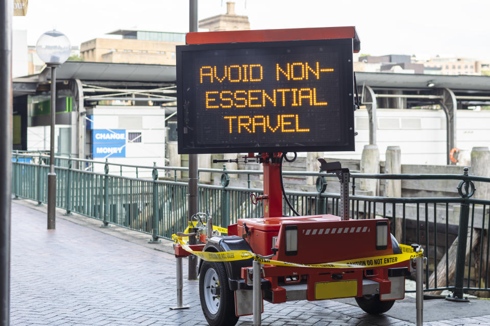 A concept to illustrate the daily impact of the Covid-19 virus on the public as a whole. A static sign displays messaging regarding the pandemic.