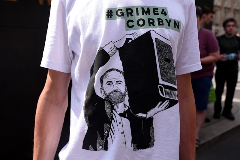 A Labour supporter wears a #Grime4Corbyn T-shirt (Photo: Anadolu Agency via Getty Images)