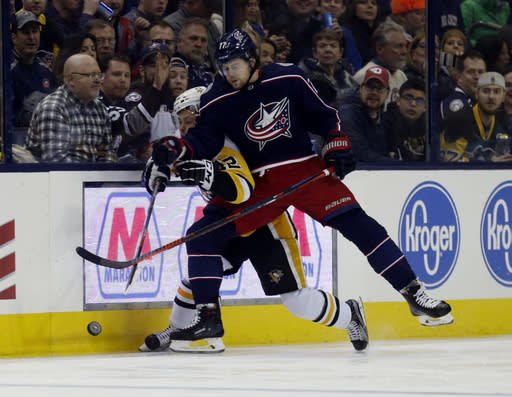 Columbus Blue Jackets forward Josh Anderson, right, checks Pittsburgh Penguins forward Dominik Simon, of the Czech Republic, during the first period of an NHL hockey game in Columbus, Ohio, Saturday, March 9, 2019. (AP Photo/Paul Vernon)