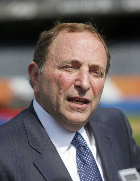 NHL Commissioner Gary Bettman talks with reporters after a news conference Thursday, Sept. 19, 2013, in Chicago on the Stadium Series hockey game between the Chicago Blackhawks and Pittsburgh Penguins on March 1, 2014, at Soldier Field in Chicago. (AP Photo/Charles Rex Arbogast)