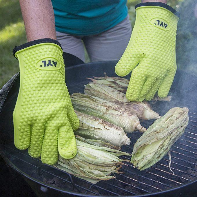 """<a href=""""https://amzn.to/2K6Yih6"""" rel=""""nofollow noopener"""" target=""""_blank"""" data-ylk=""""slk:Silicone BBQ Cooking Gloves"""" class=""""link rapid-noclick-resp"""">Silicone BBQ Cooking Gloves</a>"""