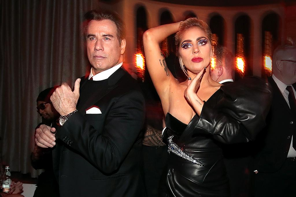 <p>John Travolta broke out some of his <i>Saturday Night Fever</i> dance moves, while Lady Gaga struck a <i>Vogue</i>-inspired pose at the Interscope bash. This moment alone made it the night's coolest Grammys afterparty! (Photo: Christopher Polk/Getty Images for Interscope) </p>