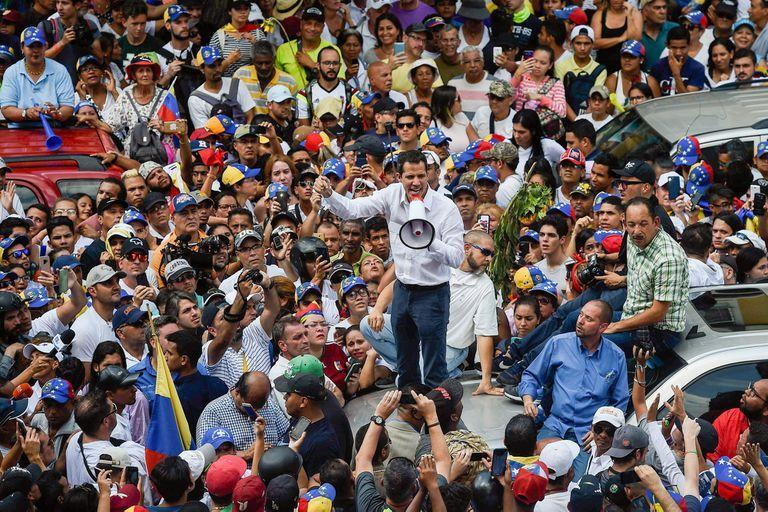 Venezuelan opposition leader and self-proclaimed acting president Juan Guaido speaks during a demo in Caracas on March 9, 2019. - Riot police blocked protesters as thousands of people took to the streets Saturday with tensions rising between opposition leader Juan Guaido and President Nicolas Maduro