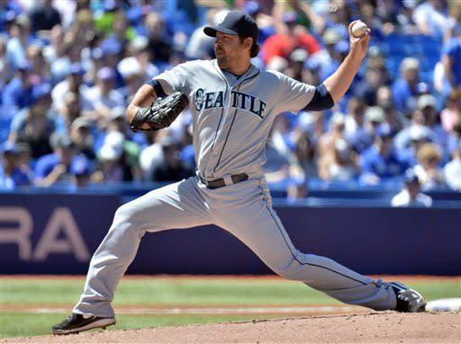 Seattle Mariners' Joe Saunders pitches against the Toronto Blue Jays during first-inning baseball game action in Toronto, Sunday, May 5, 2013. (AP Photo/The Canadian Press, Nathan Denette)