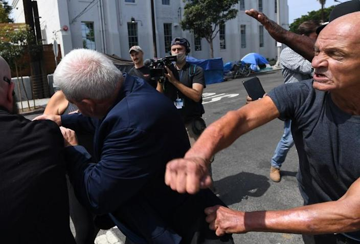VENICE, CA. September 8, 2021: A homeless man takes a swing at a staff member for Republican gubernatorial candidate Larry Elder during a tour in Venice Wednesday. (Wally Skalij/Los Angeles Times)