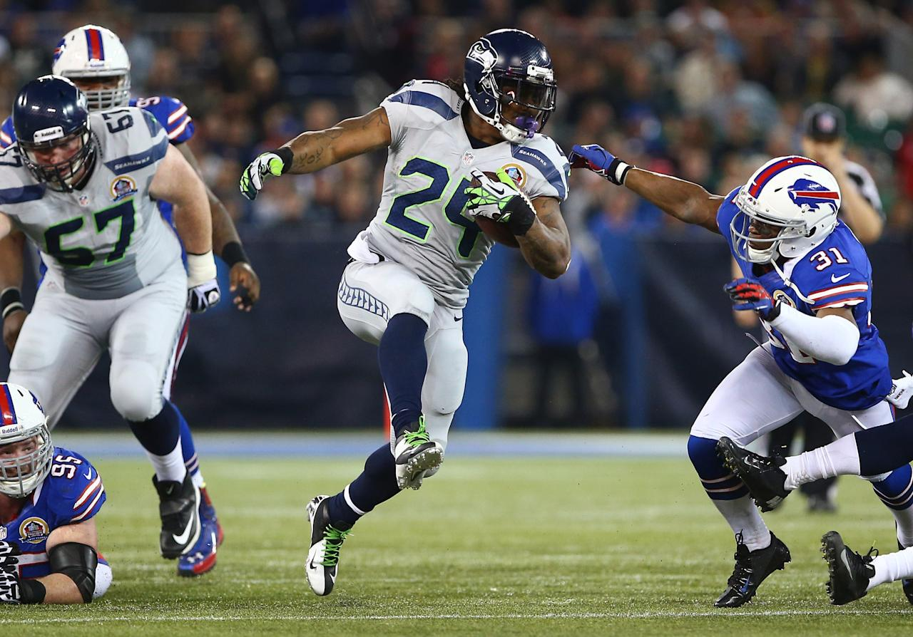 TORONTO, ON - DECEMBER 16: Marshawn Lynch #24 of the Seattle Seahawks carries the ball during an NFL game as Jairus Byrd #31 of the Buffalo Bills attempts to tackle him at Rogers Centre on December 16, 2012 in Toronto, Ontario, Canada. (Photo by Tom Szczerbowski/Getty Images)