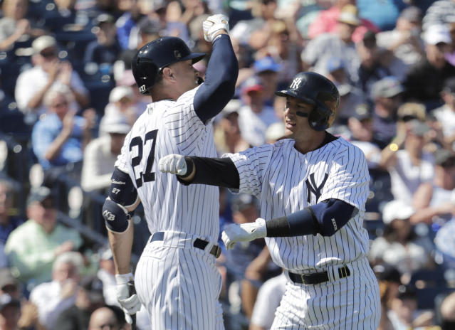 New York Yankees' Troy Tulowitzki, right, celebrates with Giancarlo Stanton after hitting a solo home run in the first inning during a spring training baseball game against the Toronto Blue Jays, Monday, Feb. 25, 2019, in Tampa, Fla. (AP Photo/Lynne Sladky)