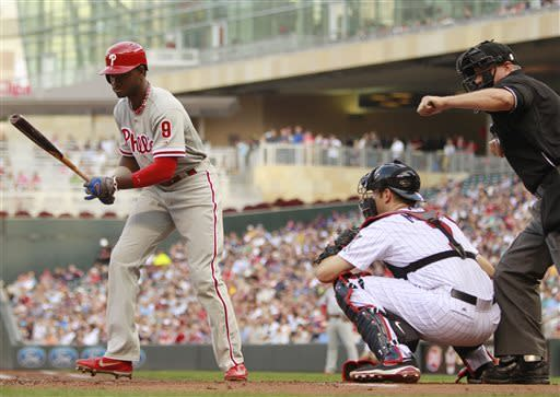 Philadelphia Phillies' Domonic Brown (9) strikes out looking against Minnesota Twins starting pitcher P.J. Walters as Twins' Joe Mauer (7) catches during the second inning of a baseball game, Tuesday, June 11, 2013, in Minneapolis. (AP Photo/Genevieve Ross)
