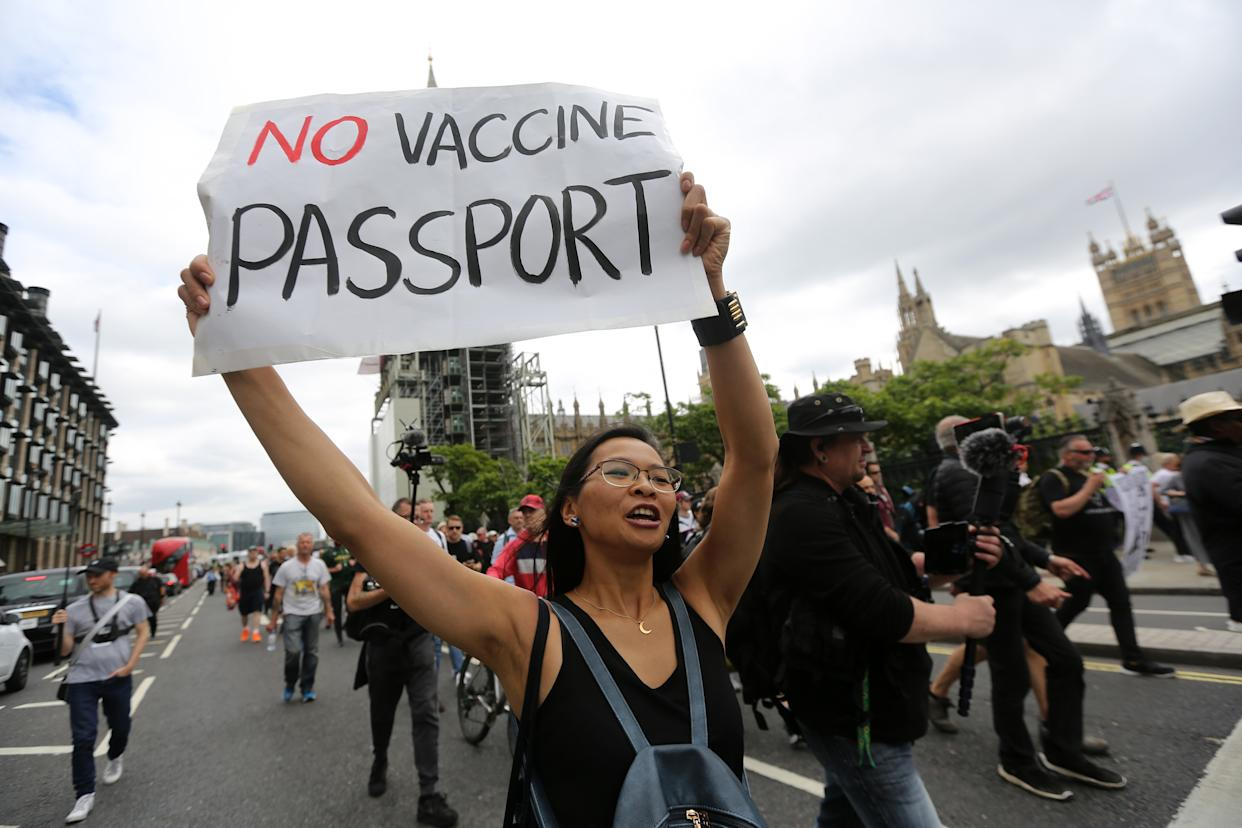 Anti-vaccine protesters march against Covid vaccine passport plans through central London