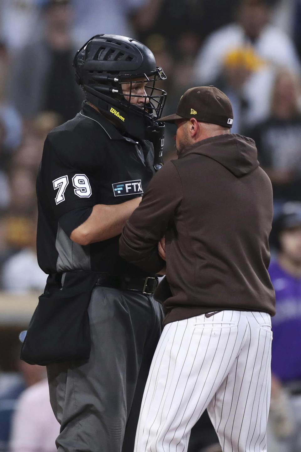 San Diego Padres manager Jayce Tingler, right, argues a called third strike with home plate umpire Manny Gonzalez (79) during the sixth inning of the team's baseball game against the Colorado Rockies on Saturday, July 31, 2021, in San Diego. Tingler was ejected. (AP Photo/Derrick Tuskan)