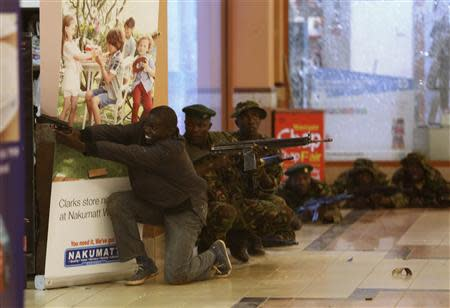 Soldiers and armed police hunt gunmen who went on a shooting spree in Westgate shopping centre in Nairobi September 21, 2013. REUTERS/Goran Tomasevic