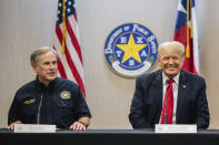 Texas Gov. Greg Abbott addresses former President Donald Trump during a border security briefing to discuss further plans in securing the southern border wall on Wednesday, June 30, 2021, in Weslaco, Texas. (Brandon Bell/Pool via AP)