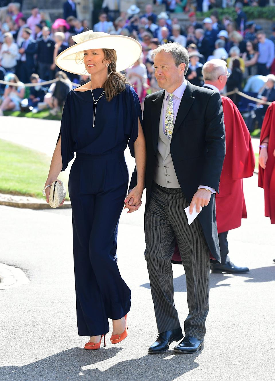 Tom Bradby attending Prince Harry's wedding to Meghan Markle in 2018 (pictured is Bradby with is wife Claudia)PA
