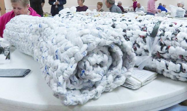 """<p>It takes more than 1,000 plastic bags to make one mat. It's a perfect use of upcycling, using something so common that, after all, won't decompose for up to 1,000 years in a landfill. <i>(Photo:<a href=""""http://www.kmvt.com/content/news/?article=352213381"""">KMVT News</a>)</i><br /></p>"""