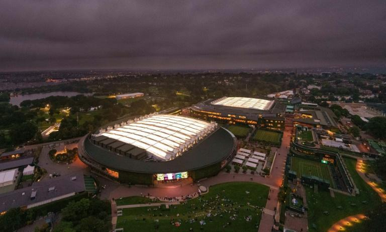 An aerial view shows No.1 Court (L) and Centre Court, after the roof was closed on both courts to allow play to continue, on the first day of the 2021 Wimbledon Championships at the The All England Tennis Club