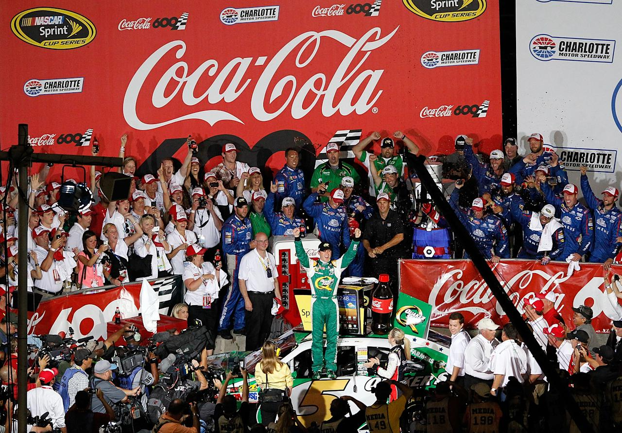 CONCORD, NC - MAY 27:  Kasey Kahne, driver of the #5 Quaker State Chevrolet, celebrates in Victory Lane after winning the NASCAR Sprint Cup Series Coca-Cola 600 at Charlotte Motor Speedway on May 27, 2012 in Concord, North Carolina.  (Photo by Streeter Lecka/Getty Images)