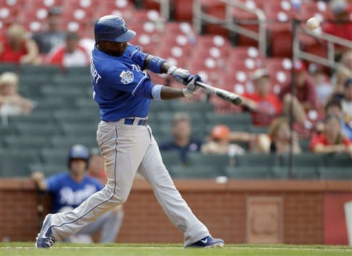 Kansas City Royals' Yuniesky Betancourt hits a two-run home run during the 15th inning of a baseball game against the St. Louis Cardinals, Sunday, June 17, 2012, in St. Louis. The Royals won 5-3. (AP Photo/Jeff Roberson)