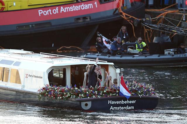 AMSTERDAM, NETHERLANDS - APRIL 30: King Willem Alexander (R) and Queen Maxima (C) of The Netherlands with daughters Princess Ariane, Princess Alexia and Princess Catharina-Amalia are seen aboard the King's boat for the water pageant to celebrate the inauguration of King Willem Alexander of the Netherlands after the abdication of his mother Queen Beatrix of the Netherlands on April 30, 2013 in Amsterdam, Netherlands. (Photo by Andreas Rentz/Getty Images)