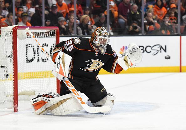 """ANAHEIM, CA – APRIL 13: <a class=""""link rapid-noclick-resp"""" href=""""/nhl/teams/ana/"""" data-ylk=""""slk:Anaheim Ducks"""">Anaheim Ducks</a> Goalie <a class=""""link rapid-noclick-resp"""" href=""""/nhl/players/5407/"""" data-ylk=""""slk:John Gibson"""">John Gibson</a> (36) makes a glove save during game 1 of the first round of the 2017 NHL Stanley Cup Playoffs between the <a class=""""link rapid-noclick-resp"""" href=""""/nhl/teams/cgy/"""" data-ylk=""""slk:Calgary Flames"""">Calgary Flames</a> and the Anaheim Ducks on April 13, 2017 at Honda Center in Anaheim, CA. The Ducks defeated the Flames 3-2. (Photo by Chris Williams/Icon Sportswire via Getty Images)"""