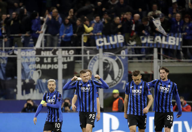 "FILE - In this Wednesday, Feb. 19, 2020 file photo, Atalanta's Josip Ilicic, second left, celebrates with teammates after scoring his side's second goal during the Champions League round of 16, first leg, soccer match between Atalanta and Valencia at the San Siro stadium in Milan, Italy. It was the biggest soccer game in Atalanta's history and a third of Bergamo's population made the short trip to Milan's famed San Siro Stadium to witness it. Nearly 2,500 fans of visiting Spanish club Valencia also traveled to the Champions League match. More than a month later, experts are pointing to the Feb. 19 game as one of the biggest reasons why Bergamo has become one of the epicenters of the coronavirus pandemic — a ""biological bomb"" was the way one respiratory specialist put it — and why 35% of Valencia's team became infected. The new coronavirus causes mild or moderate symptoms for most people, but for some, especially older adults and people with existing health problems, it can cause more severe illness or death. (AP Photo/Luca Bruno, File)"