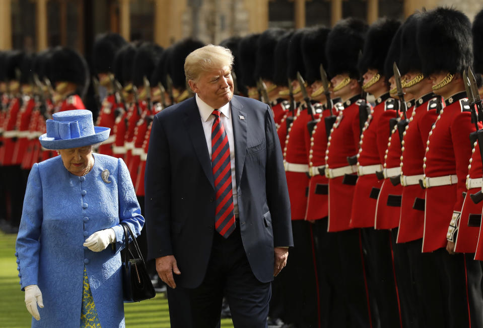 FILE - In this July 13, 2018, file photo U.S. President Donald Trump and Britain's Queen Elizabeth II inspect a Guard of Honour, formed of the Coldstream Guards at Windsor Castle in Windsor, England. (AP Photo/Matt Dunham, Pool, File)