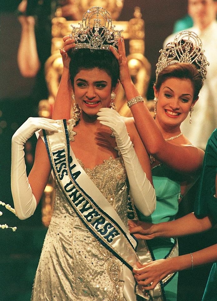 <p>Sushmita Sen being crowned by previous year's winner Dayanara Torres after she won the Miss Universe 1994 final in Manila. The 18-year old model beat 76 other contestants to become the first Indian to win the world's most prestigious beauty pageant. </p>