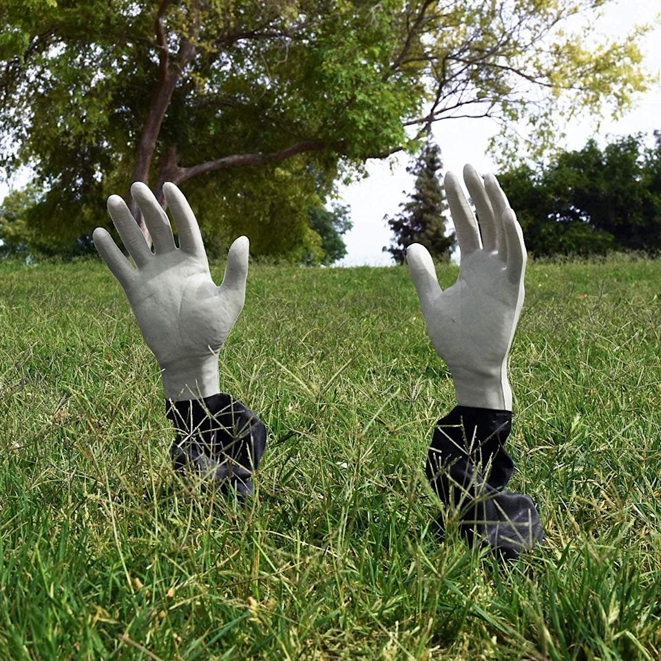 <p>Place these <span>Kangaroo Lawn Zombie Hands</span> ($9) in the grass.</p>