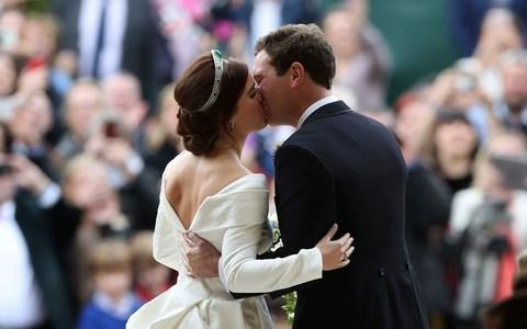 The newlyweds kiss on the steps as Royal family gains its newest member - Credit: PA