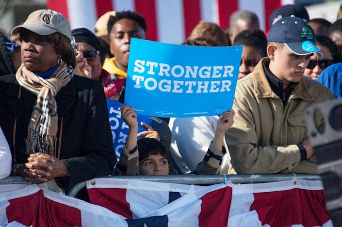 A child supporter holds up a placard as US President Barack Obama speaks at a Hillary for America campaign event in Cleveland, Ohio, October 14, 2016 (AFP Photo/Jim Watson)