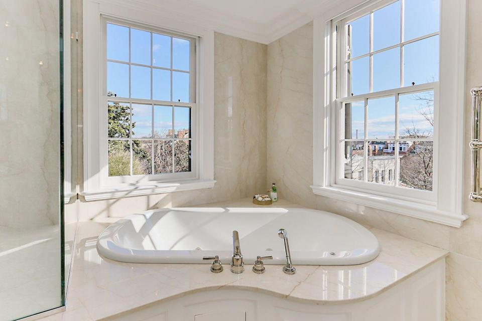 <p>Look out over all of Georgetown from the comfort of a palatial tub. </p>