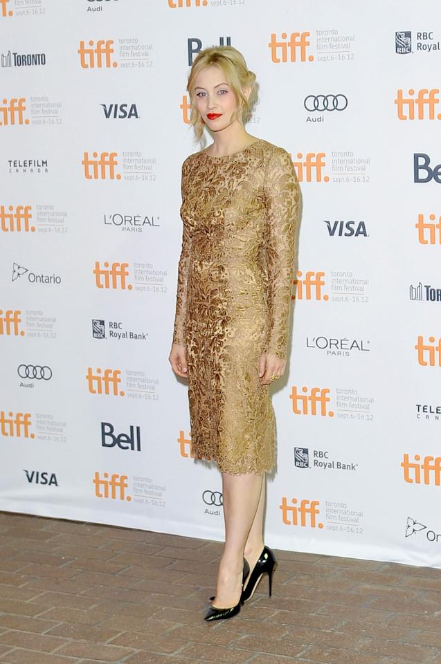"WORST: This dress is absolutely beautiful, with intricate detailing and a beautiful cut. And ""Antiviral"" star Sarah Gadon herself is an incredibly beautiful woman. Unfortunately, the dress' gold hue washes out Gadon, whose skin is already incredibly pale. We love the shoes, though!"