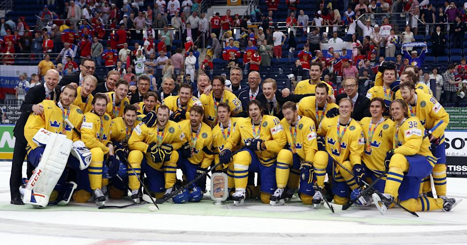 Team Sweden celebrates their third place after the bronze medal match between Sweden and Czech Republic at the Ice Hockey World Championship in Minsk, Belarus, Sunday, May 25, 2014. (AP Photo/Darko Bandic)