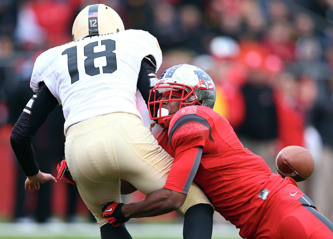 PISCATAWAY, NJ - NOVEMBER 10:  Chris Boldt #18 of the Army Black Knights loses the ball after he is hit by Quron Pratt #7 of the Rutgers Scarlet Knights on November 10, 2012 at High Point Solutions Stadium in Piscataway, New Jersey.The Rutgers Scarlet Knights defeated the Army Black Knights 28-7.  (Photo by Elsa/Getty Images)