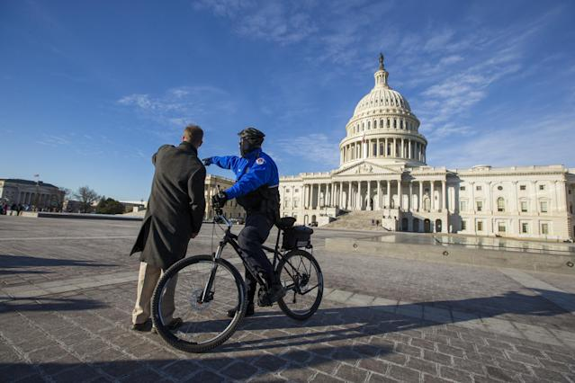 <p>A United States Capitol Police Officer gives directions outside the United States Capitol Building on the morning of Jan. 19, 2018, as Congress works to pass a spending bill by midnight. Failure to do so would shut down the United States government. (Photo: Alex Edelman/CNP via ZUMA Wire) </p>