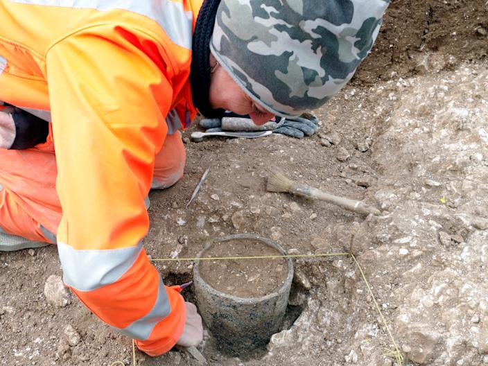 Late Bronze Age vessel being excavated south of Longbarrow Crossroads on the A303.JPG
