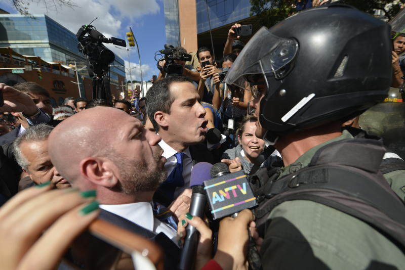 Opposition leader Juan Guaido argues for National Guards to let him and all opposition lawmakers into the National Assembly, outside the legislature in Caracas, Venezuela, Tuesday, Jan. 7, 2020. Venezuela's opposition is facing its biggest test yet after government-backed lawmakers announced they were taking control of what Guaidó supporters have described as the nation's last democratic institution. (AP Photo/Matias Delacroix)