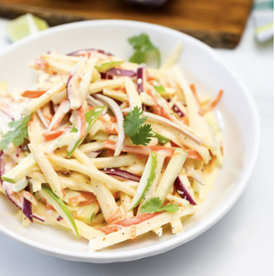 """<p>This jicama slaw is rich, creamy, and checks all the boxes of your raw vegan diet. The slaw is a mix of sweet and sour flavors with tart apples balancing out the sweet jicama. </p><p><a class=""""link rapid-noclick-resp"""" href=""""https://healthiersteps.com/recipe/vegan-jicama-slaw/#ingredients"""" rel=""""nofollow noopener"""" target=""""_blank"""" data-ylk=""""slk:Get the recipe"""">Get the recipe</a><br><em><br>Per serving: 195 kal, 10 g fat, 24.3 g carbs, 1.3 g protein</em></p>"""