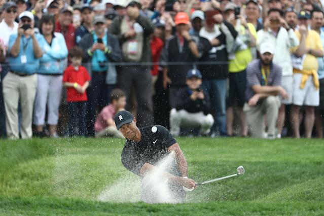 Tiger Woods of the United States plays a shot from a bunker on the first hole during the second round of the 2019 PGA Championship at the Bethpage Black course on May 17, 2019 in Farmingdale, New York. (Photo by Jamie Squire/Getty Images)