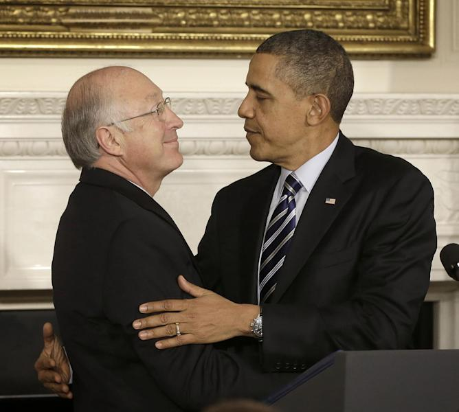 FILE - In this Feb. 6, 2013 file photo, President Barack Obama embraces outgoing Secretary of Interior Ken Salazar in the State Dining Room of the White House in Washington. Salazar announced Thursday, June 6, 2013, that he is opening a law office in Denver for WilmerHale as a partner. (AP Photo/Pablo Martinez Monsivais, File)